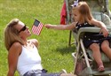 11September2011  Bethany Graham of Portage and daughter Reese share a small U. S. flag during the City of Portage memorial service of the tenth anniversary of the 911 attack.  Bethany's husband and Reese's father William is a Portage fire fighter who is a member of the departments color guard. ( Special to the Gazette/John A. Lacko )