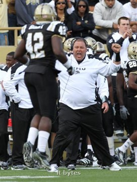 (17 Sept. 2011) Western Michigan defensive line coach Lou Esposito screams in joy from the sidelines as Devon Brant (42) heads off the field in second quarter action. Central Michigan University faced host Western Michigan University, arch Mid-American conference rivals, in a football game in Kalamazoo, Mich., on Sept. 17, 2011.  (John A. Lacko / Special to the Kalamazoo Gazette)