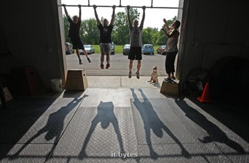 03June2011  Participants do chin ups in a doorway during a workout session at Crossfit AZO, a new business on Lovers' Lane.   (Special to the Gazette / John A. Lacko)