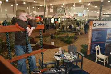 09March2011  Five-year-old Drake DeLeeuw pauses after climbing a play structure at the 2011 Home Builders Association of Kalamazoo Home Expo Wednesday evening.   (John A. Lacko /  Special to the Gazette)