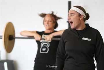 03June2011  Sara Barnett of Galesburg keeps going as Erin Carlson yells to stop as she leads a workout session at Crossfit AZO, a new business on Lovers' Lane.   (Special to the Gazette / John A. Lacko)