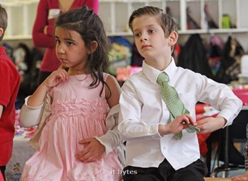 "12February2011 Kindergarteners Makaila Almagur and Kameron White fidget while listening to instructions during ""Waltzing and Wands,"" a magical tea party held by Mrs. Angela Newton's kindergarten class at Paramount Charter Academy  for Valentines Day Monday morning. (John A. Lacko / Special to the Gazette)"