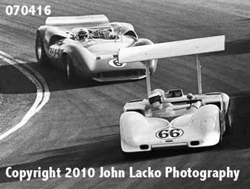 15Oct1967  Jim Hall (66) in his Chaparral 2G-Chevrolet leads Mark Donohue (6) in his Lola T70 Mk3B-Chevrolet through the corkscrew.  Hall finished second and Donohue went out on lap 74 with a blown engine.