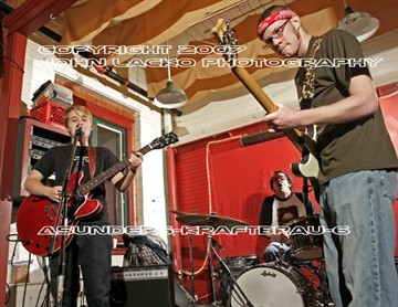 "11/25/07   The ""Asunders"" with Leigh Kornhauser, Isaac Turner and Aaron Smith opened the final concert at Kraftbrau Brewery Sunday evening."