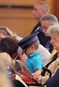 "11Septembert2011  Mason Clearwater, 5 tries on his father's hat during St. Augustine Cathedral ""Blue Mass"" honoring miliatry, police, firefighters and emergency medical technicians Sunday morning.  Mason's father, Ben is a State Policeman at the Wayland Post.   (Special to the Gazette / John A. Lacko)"