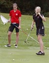 29September2011  Allegan High School senior Katrina Tooker (right) reacts to her putt stopping too short as Vicksburg High School senior Darby Truhn watches on the tenth green during the Wolverine Conference Girls' Golf championship at Lake Cora Hills near Paw Paw.   (Special to the Gazette / John A. Lacko)